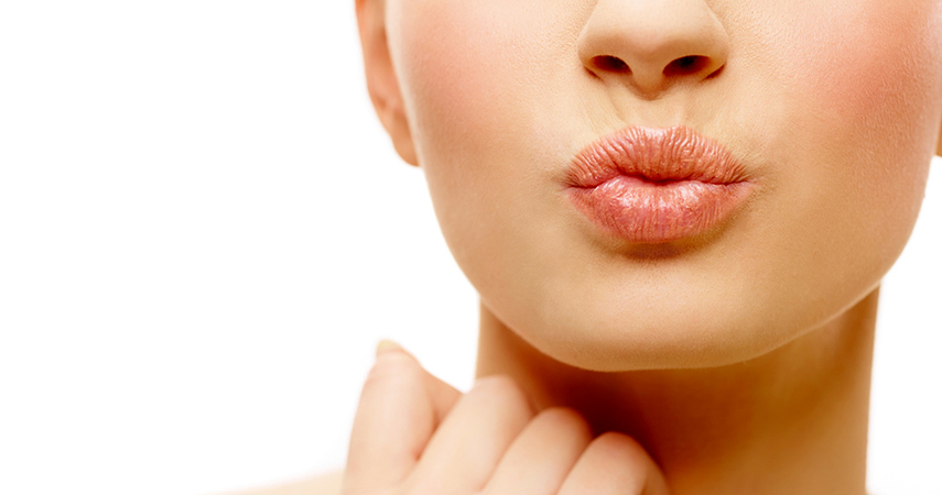 Learn how to heal cracked lips to get healthy, smooth lips like this woman's.
