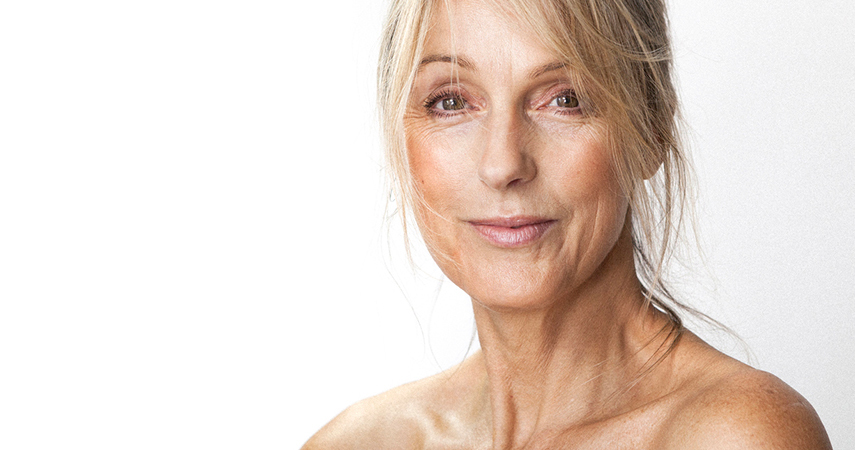 A woman in her fifties looks beautiful even with aging skin.