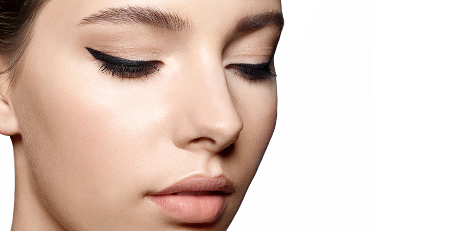 Winged eyeliner extends from the outer corner of the eye.