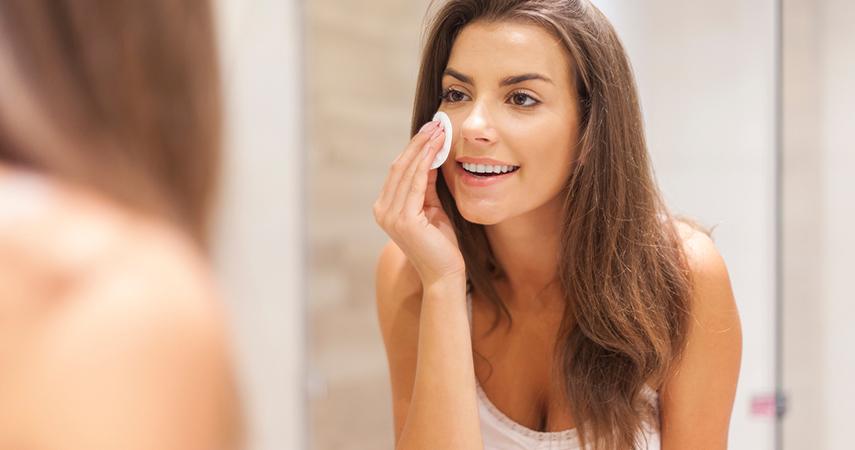 Woman removing face makeup