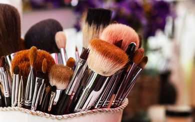 many used makeup brushes in a container