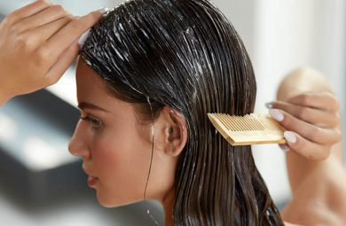 A woman is deep conditioning her hair