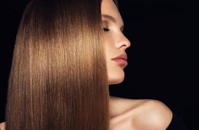 A woman has shiny, hydrated hair