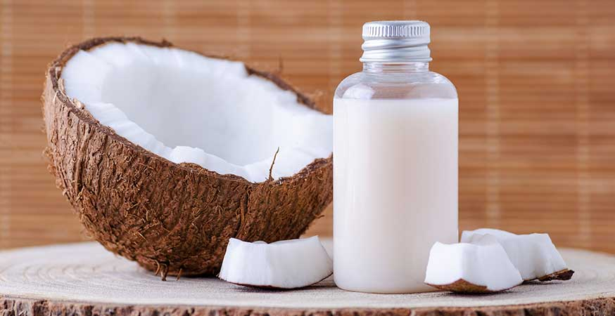 A bottle of soap and a coconut.