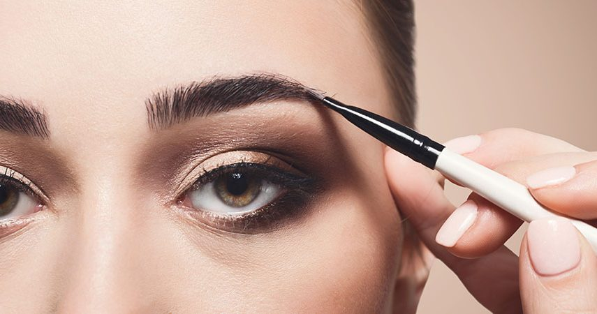 Brow gel is being applied to eyebrows