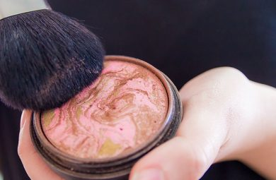 Close up of woman hands holding makeup bronzer