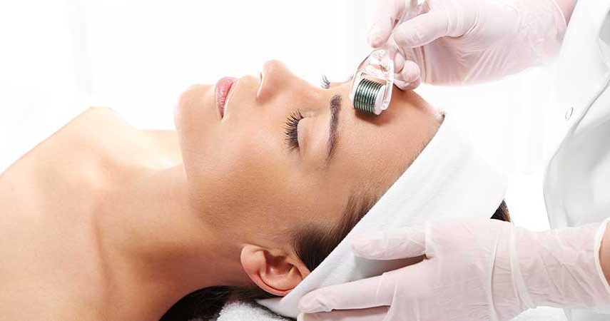 A woman getting a microneedling treatment done on her face