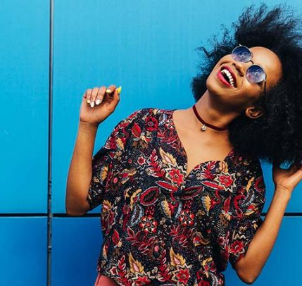 black girl dancing against a blue background
