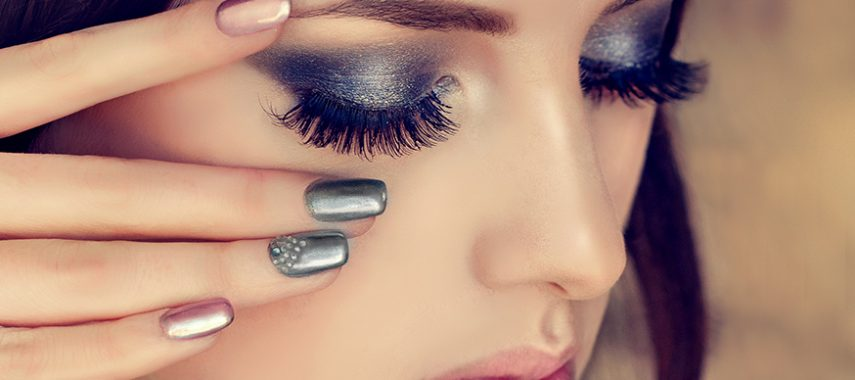 woman is showing smokey eyes style make up