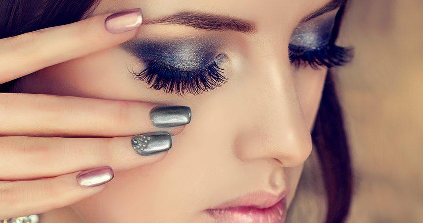 woman is showing smokey eyes style make up