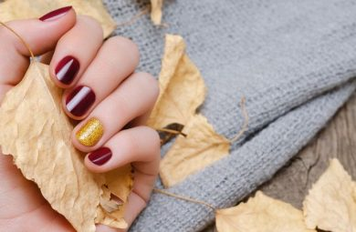 Someone showing off popular Fall nail colours.