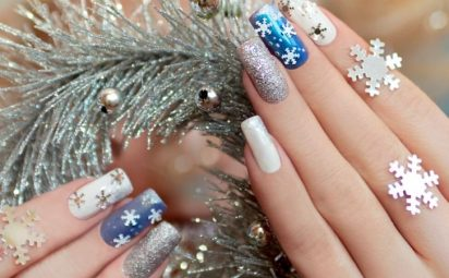 Someone showing off their holiday nail deisgn.