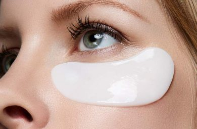 Someone wearing a white under-eye mask.
