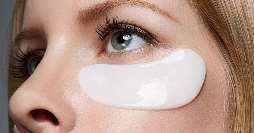 Someone wearing a white under-eye mask.
